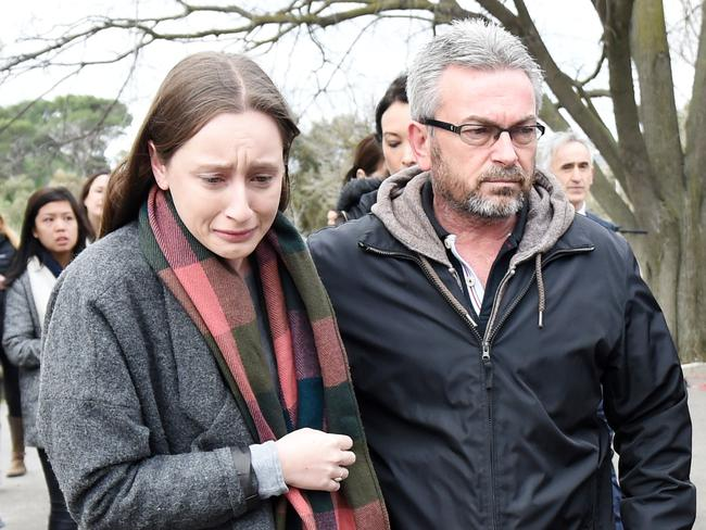 Borce Ristevski and his distressed daughter Sarah after they walked out of a press conference in which Mr Ristevski was asked of he killed his wife. Picture: AAP/ Tracey Nearmy