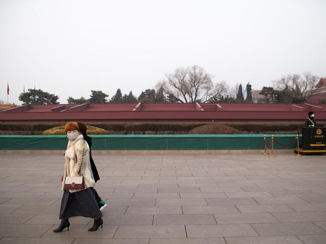 Tiananmen Gate is normally filled with tourists, but has been empty since Chinese officials restricted travel and tourism earlier this week. Picture: Betsy Joles/Getty Images.