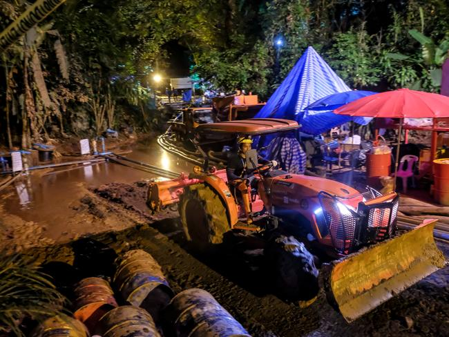 A bulldozer clears out the surface of the drilling well site at the entrance of the cave. Picture: Linh Pham/Getty Images