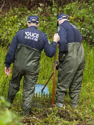 Police search bushland at Batar Creek for the boy. Picture: Shane Chalker.