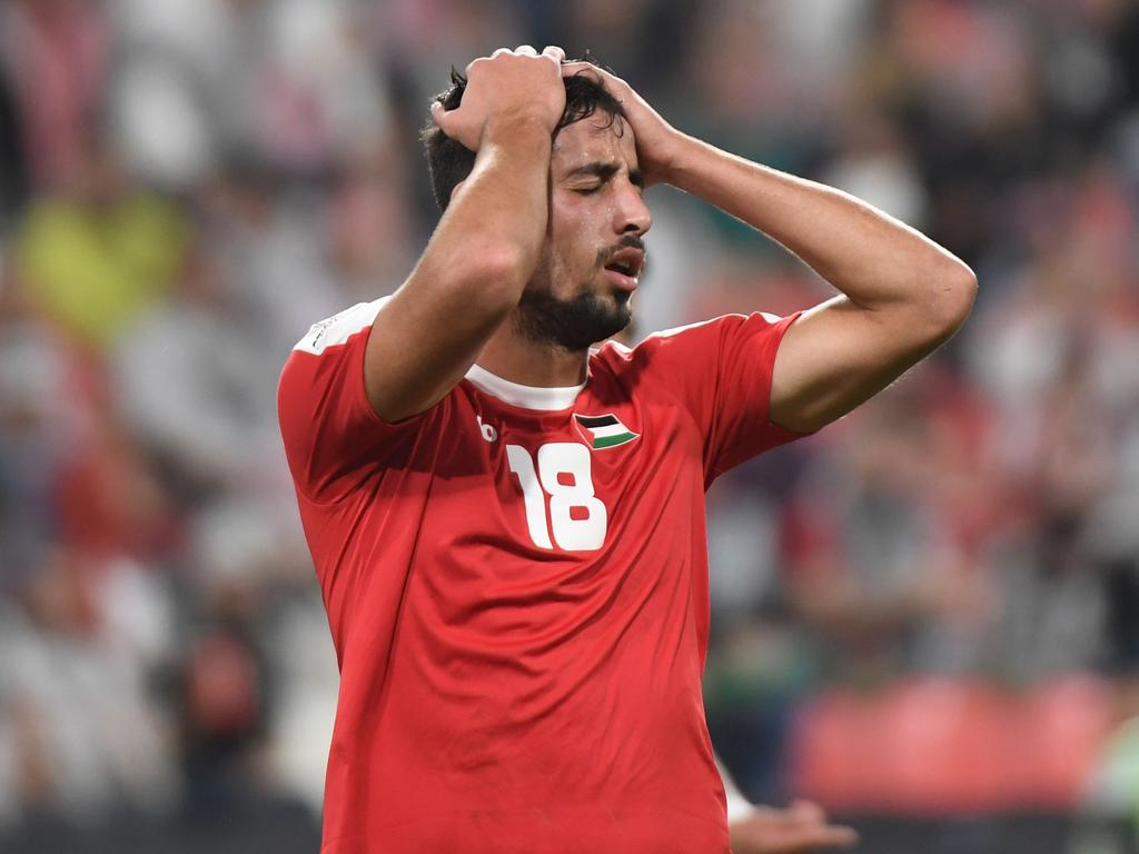 Palestine's midfielder Oday Dabbagh reacts after a missed shot during the 2019 AFC Asian Cup group B football match between Palestine and Jordan at the Mohammed Bin Zayed Stadium in Abu Dhabi on January 15, 2019. (Photo by Khaled DESOUKI / AFP)