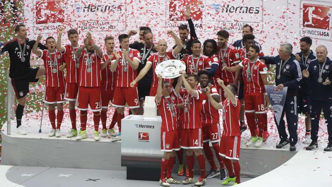 Bayern Munich lift the Bundesliga trophy.