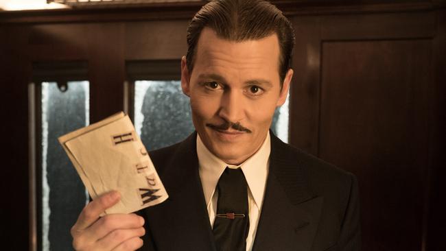 707c9d5a71fa Johnny Depp as Ratchett in a scene from Twentieth Century Fox's film Murder  on the Orient