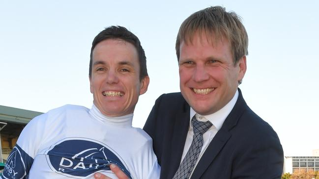 Jockey Tim Clark and trainer Bjorn Baker celebrate Samadoubt's win in the first Group 1 race of the season. Picture: AAP