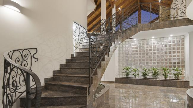 The marble staircase makes for a grand entrance to 1 Sutherland Court, Mount Ommaney.