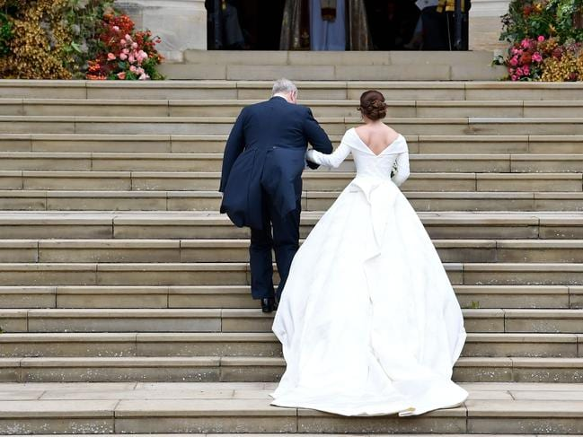 Britain's Princess Eugenie of York arrives accompanied by her father Prince Andrew, Duke of York. Picture: AFP