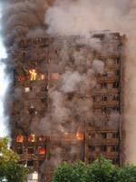Police and firefighters were called at 1.16am to reports the large fire at a block of flats in the Lancaster West Estate, W11. About 200 firefighters were soon tackling the blaze. Picture: Jamie Lorriman/The Sun