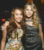 <p>Singers Miley Cyrus (Left) and Taylor Swift pose at the 2009 Grammy Salute to Industry Icons event, honoring Clive Davis in Beverly Hills, California February 7, 2009. REUTERS</p>