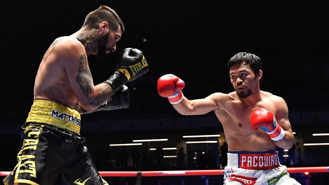 Philippines' Manny Pacquiao (R) fights Argentina's Lucas Matthysse during their world welterweight boxing championship bout at Axiata Arena in Kuala Lumpur on July 15, 2018.