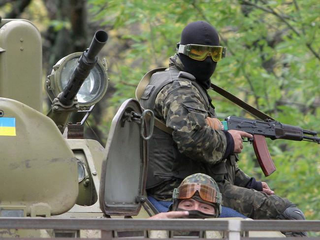 """Pointing fingers ... Russian media allege Ukrainian forces tortured and killed the four civilians, with Kiev calling the reports """"Russian disinformation"""". Picture: Anatolii Boiko"""