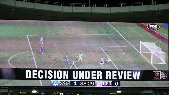 A screen shows a video review during the A-League