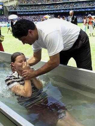 One of 500 to get baptised at the Jehovah's Witnesses convention at Telstra Stadium in Sydney, 2003. Picture: Kristi Miller.