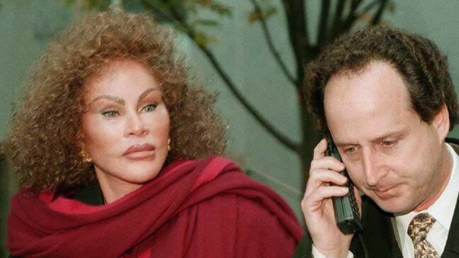 Jocelyne Wildenstein, wife of art dealer Alec Wildenstein, outside court with her lawyer Bernard Clair Mar and his giant mobile phone.