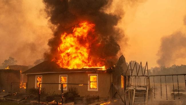 A home burns at a vineyard during the Kincade fire near Geyserville, California. 180,000 people have been told to evacuate northern California. (Photo by Josh Edelson / AFP)