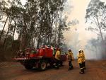 Firefighters battle bushfires in Busbys Flat, northern NSW, Wednesday, October 9, 2019. (AAP Image/Jason O'Brien)