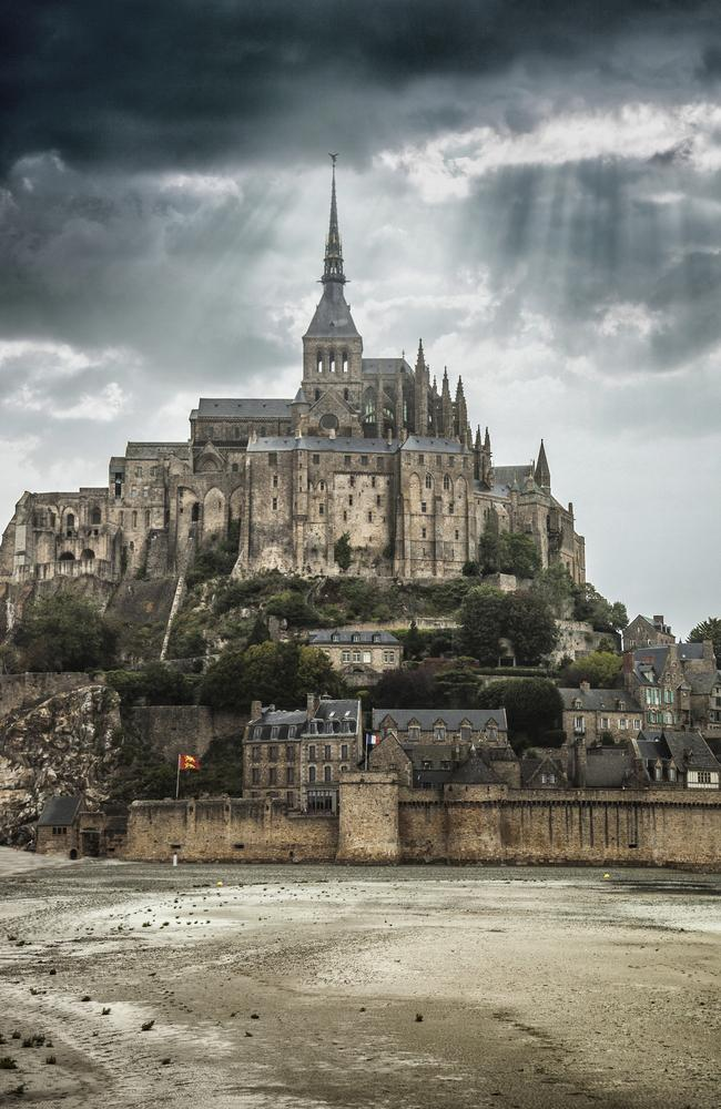 View to Le Mont Saint Michel in Normandy under a storm.