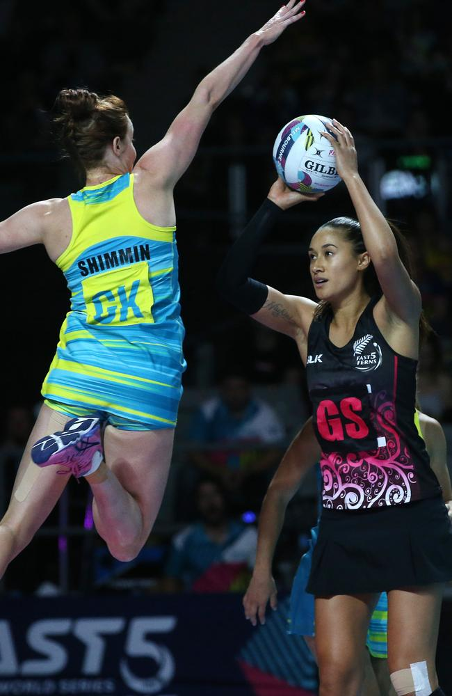 Just look at these incredible athletes. New Zealand star Maria Tutaia shoots as Kate Shimming tries to defend. Picture: Michael Klein