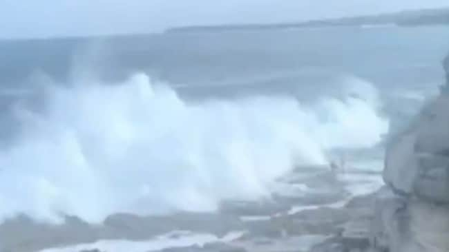 The moment two Russian nationals were swept off rocks during large swells at Bondi Beach, Sydney, on Saturday February 15, 2020. One of them, Andrei Ivanov, drowned. Picture: 9NEWS