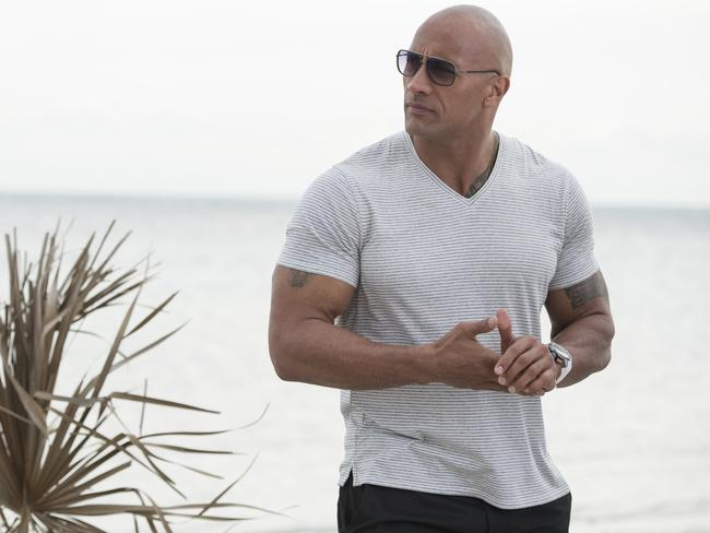 Dwayne Johnson is the highest-paid actor in Hollywood but credits his humble nature with not forgetting where he came from. Picture: AP