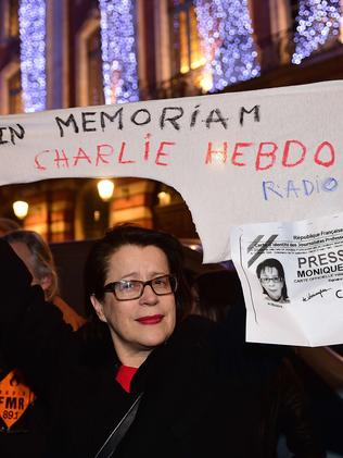 A woman demonstrates in Toulouse for press freedom. Picture: AFP/Eric Cabanis