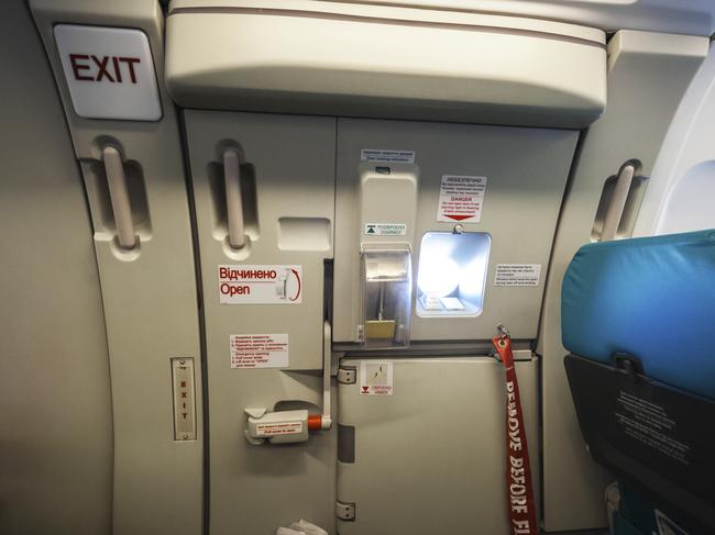 First-time flyer accidentally tries opening emergency exit ...
