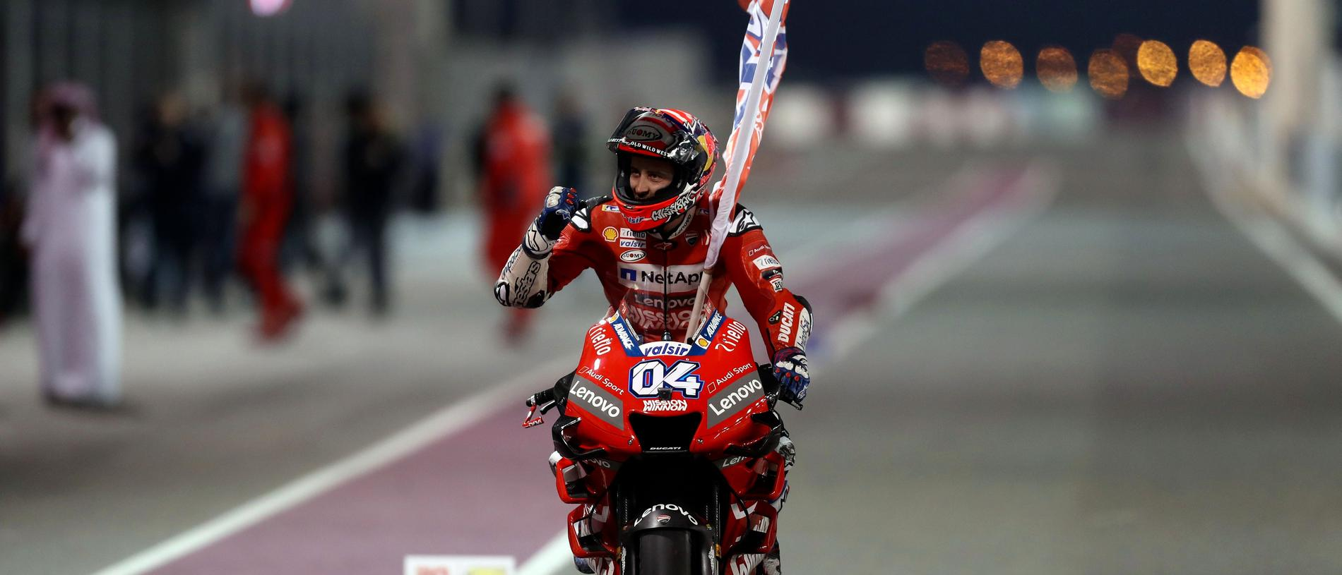 Mission Winnow Ducati's Italian rider Andrea Dovizioso celebrates winning the Qatar MotoGP grand prix at the Losail track in Qatar's capital Doha on March 10, 2019. (Photo by KARIM JAAFAR / AFP)