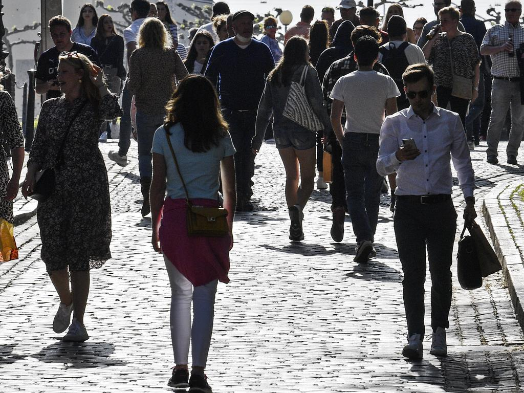 A lot of people enjoy the evening sun in Duesseldorf, Germany, despite the social distancing order. Picture: AP