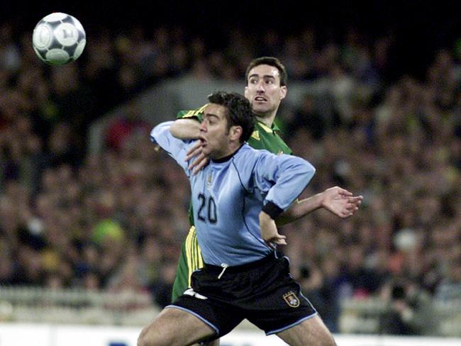 Uruguay striker Alvaro Recoba does battle with Tony Vidmar in a 2001 World Cup play-off clash.