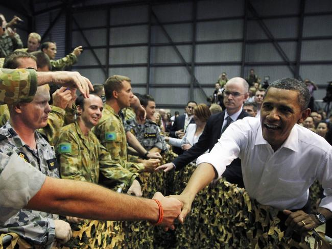 President Barack Obama met Australian troops during a visit to the Royal Australian Air Force base in Darwin in 2011. The trip had a second important purpose. Picture: Charles Dharapak/AP