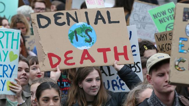 Protesters in the climate rally today. Picture: AAP Image/David Crosling