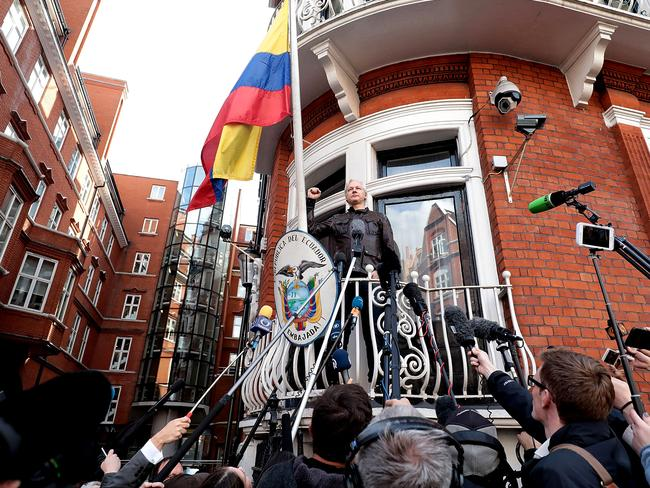 Julian Assange speaks to the media from the balcony of Ecuador's embassy in London. Picture: Jack Taylor/Getty Images