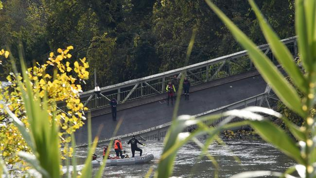 Rescuers sail near a suspension bridge which collapsed on November 18, 2019 in Mirepoix-sur-Tarn, near Toulouse, southwest France. Picture: Eric Cabanis / AFP