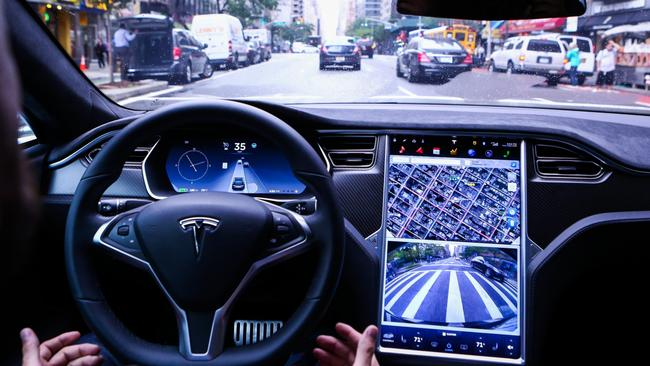 Tesla's Autopilot feature can keep the moving vehicle in its lane. PHOTO: BLOOMBERG NEWS