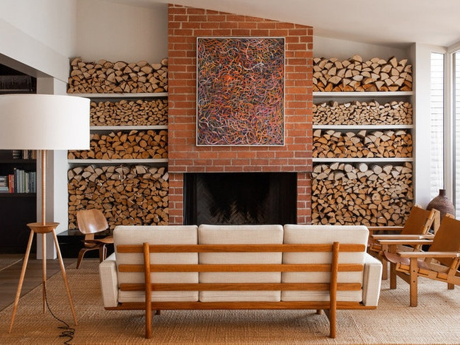 The living room's fireplace has an elaborate log display. Picture: Mansion Global