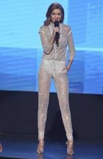 Co-host Gigi Hadid speaks at the 2016 American Music Awards. Picture: AP