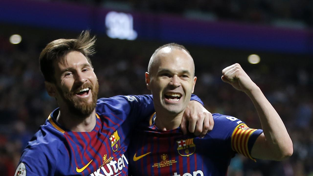 Barcelona's Andres Iniesta, right, celebrates withLionel Messi after scoring his side's fourth goal during the Copa del Rey final