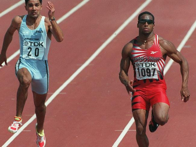Ato Boldon of Trinidad and Tobago (r) during the Men's 100m qualifying heat at the World Track and Field Championships at the Olympic Stadium in Athens, 1997. (AP Photo/Michel/Lipchitz)