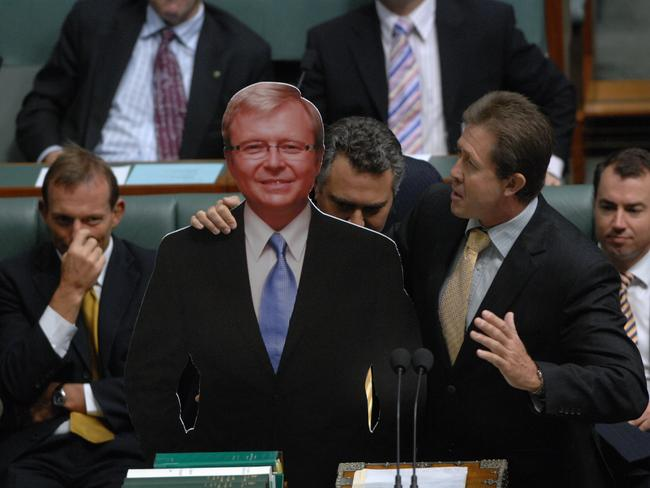 So flimsy! National MP Luke Hartsuyker holding a cardboard cutout of then Prime Minister Kevin Rudd in the House of Representatives.