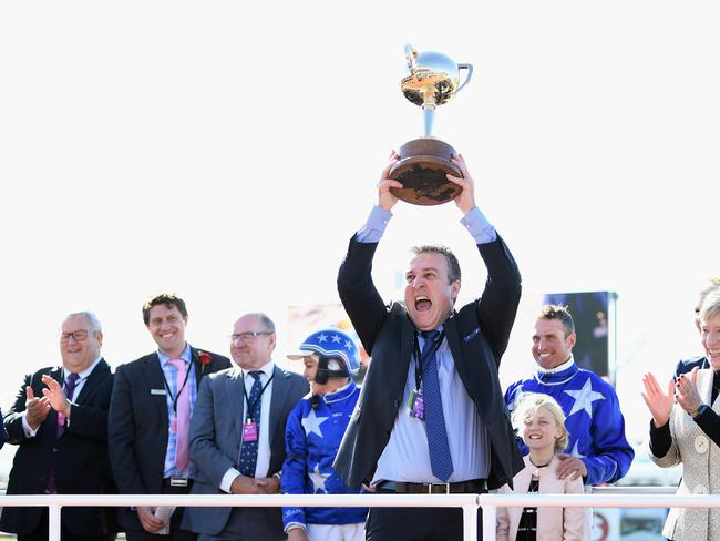 Geelong-based managing owner Danny Zavitsanos lifts the New Zealand Cup trophy. Picture: Getty Images