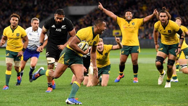 Wallabies fullback Kurtley Beale crosses for a try in Australia's rout of the All Blacks in Perth.