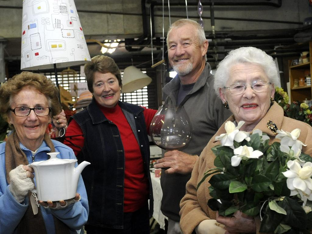 President of the Dalwood Auxiliary, John Darragh, (second from right) at a jumble sale to help raise money for Dalwood, is opposed to the proposed land sell-off. Picture: News Corp