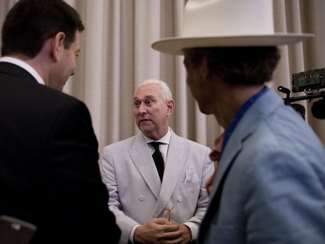 Donald Trump adviser Roger Stone (centre) speaks to reporters in New York in July 2016 about his communications with a Russia-linked hacker behind the DNC breach. The hacker has since been identified as Guccifer 2.0.Picture: AP/Mary Altaffer