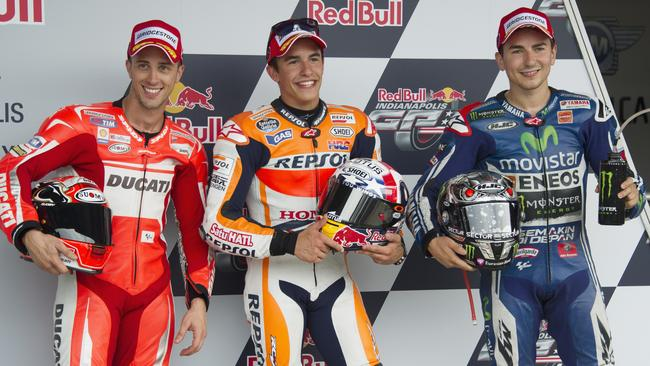 Andrea Dovizioso of Italy and Ducati Team, Marc Marquez of Spain and Repsol Honda Team and Jorge Lorenzo of Spain and Movistar Yamaha MotoGP pose at the end of the qualifying practice.