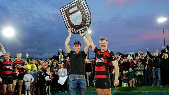 Former Northern Suburbs coach Simon Cron and captain Will Miller hold up the Shute Shield in 2016.