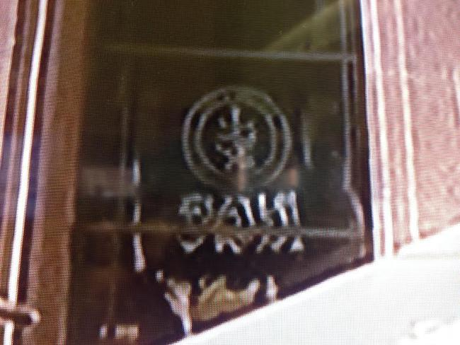The Black Standard flag is seen in the window of the Lindt cafe / Picture: Channel 7
