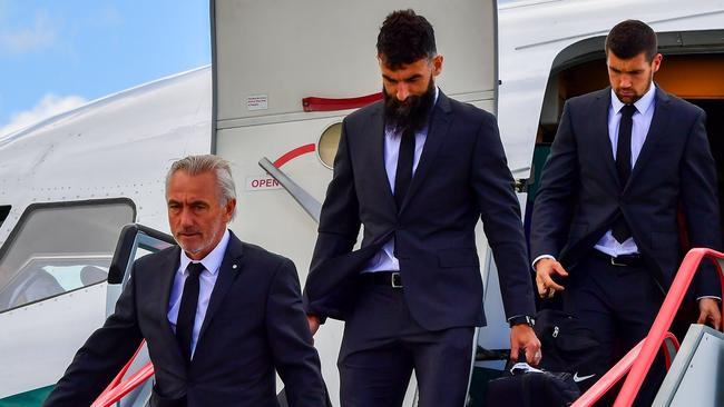Australia football team's coach Bert van Marwijk (L) players Mile Jedinak (C) and Mat Ryan disembark from their aeroplane at Kazan airport.