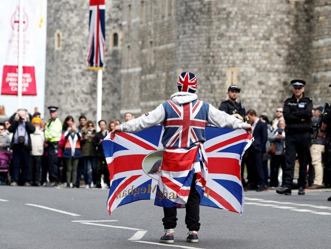 Royal super fan John Loughery walks with a Union flag outside Windsor Castle. Picture: AFP