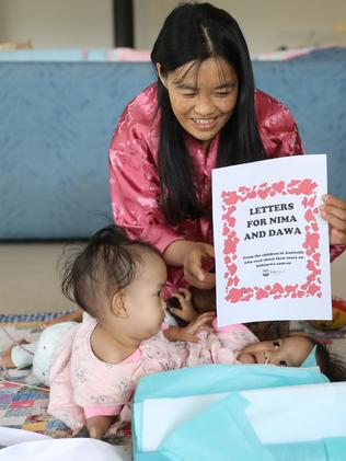 Nima and Dawa, with mum Bhumchu, receive letters from kidsnews.com.au. Picture: Alex Coppel