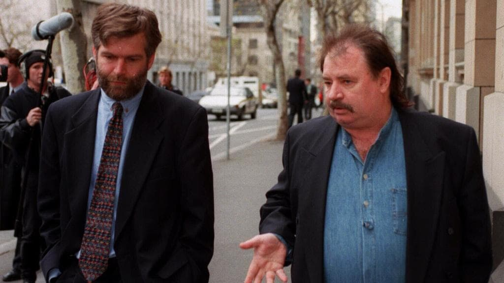 Dennis Galimberti and Les Twentyman leave the Supreme Court in 1996 after failing to get an injunction against the Fitzroy Football Club.