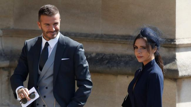 David Beckham was all smiles, while his wife ... was not. Credit: AFP Photo/Pool and AFP Photo/Odd Andersen